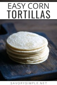 "A stack of homemade corn tortillas on a cutting board with text overlay ""easy corn tortillas"""