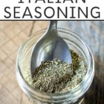 Homemade Italian Seasoning in a mason jar with a spoon and text overlay
