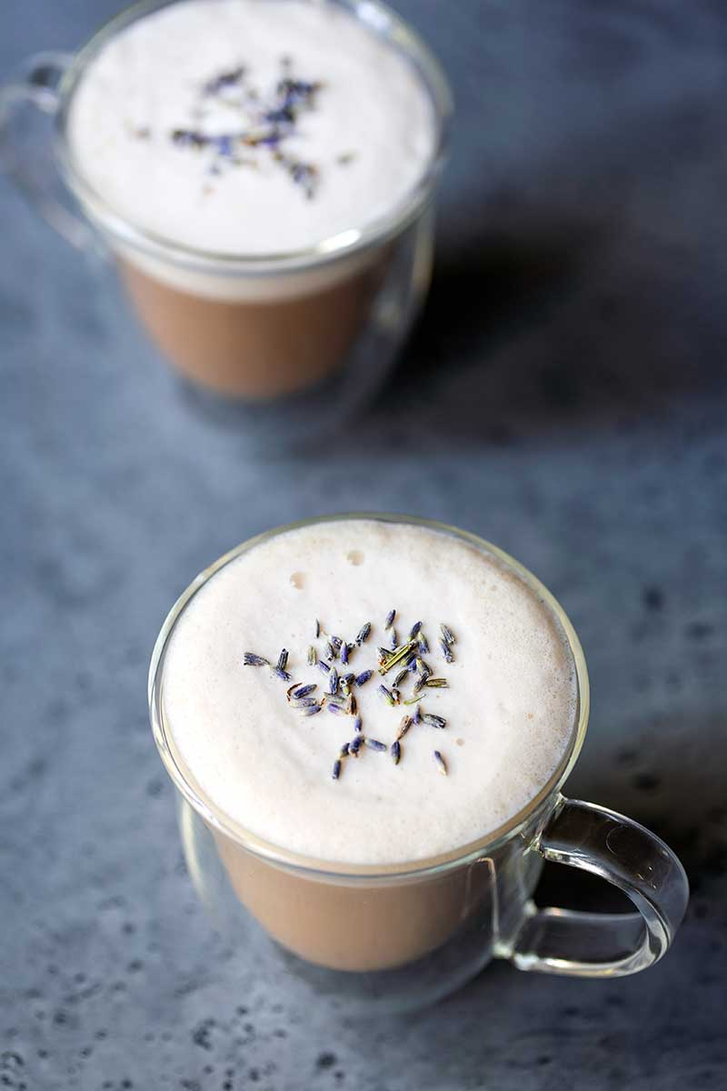 overhead photo: London Fog Latte in 2 clear mugs, topped with dried lavender