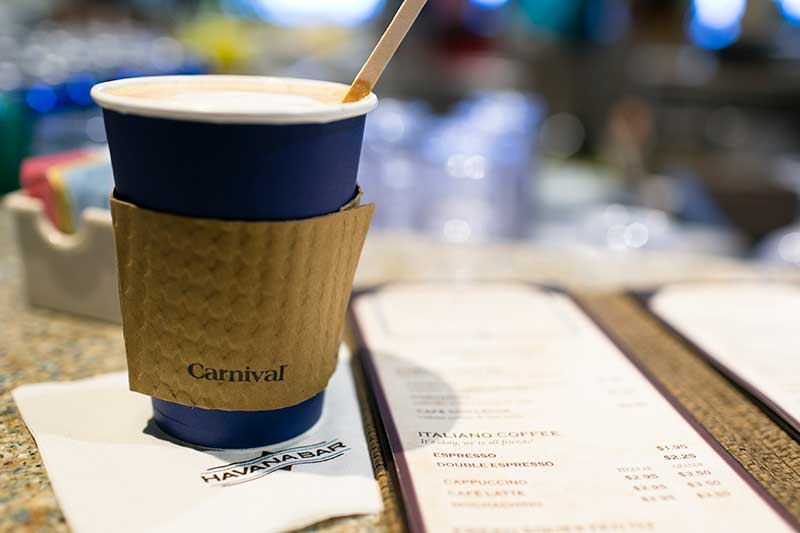 Coffee from Carnival's Havana Bar, sitting on a napkin next to a menu