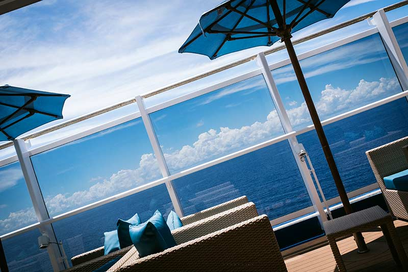 The quiet deck on Carnival Horizon, with umbrellas and lounge chairs