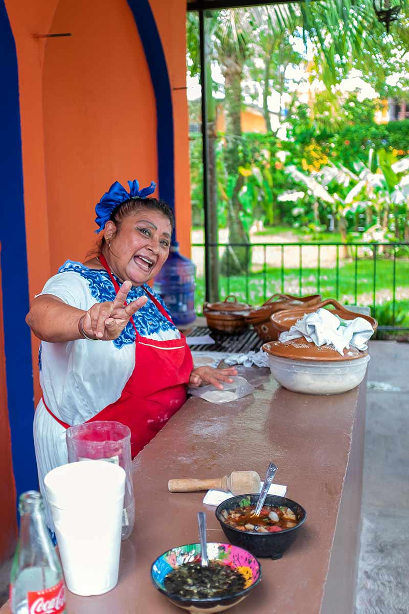 A woman in Cozumel making tacos
