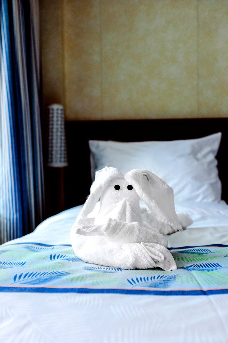 towel animal on bed in Carnival balcony room