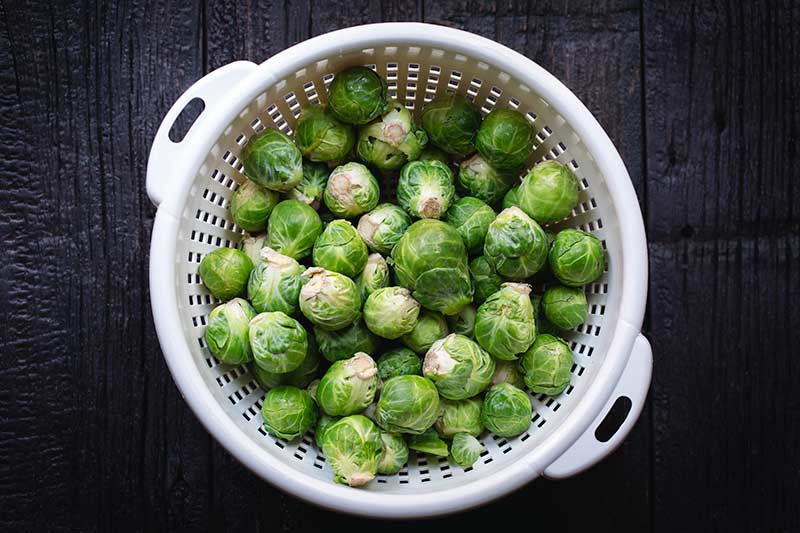 Whole brussel sprouts in a colander
