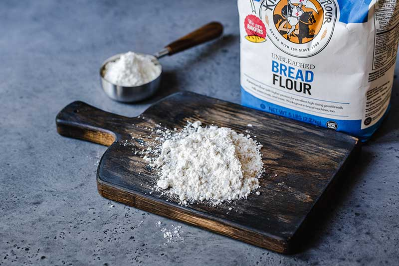 bread flour on a cutting board next to the package