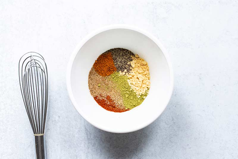 A bowl with unblended spices for old bay recipe ingredients