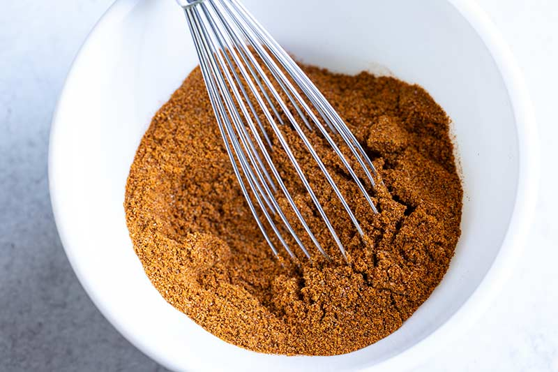 close up of homemade spice blend and whisk