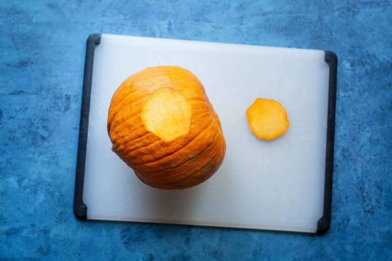 A slice of pumpkin removed to create a flat surface