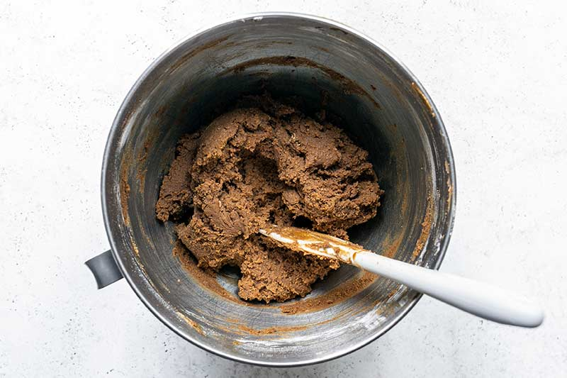 old fashioned molasses cookie dough fully mixed in a stand mixer bowl