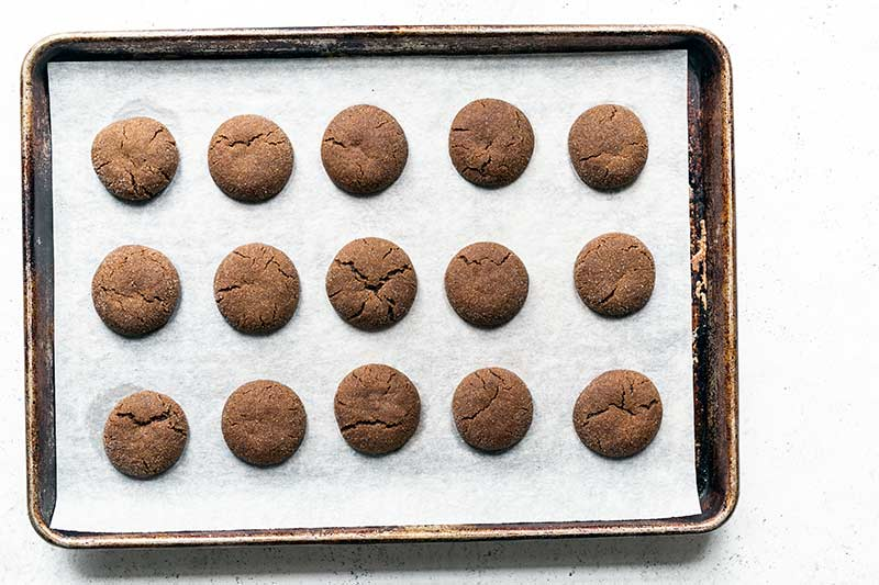 A sheet pan with soft old fashioned molasses cookies, just out of the oven
