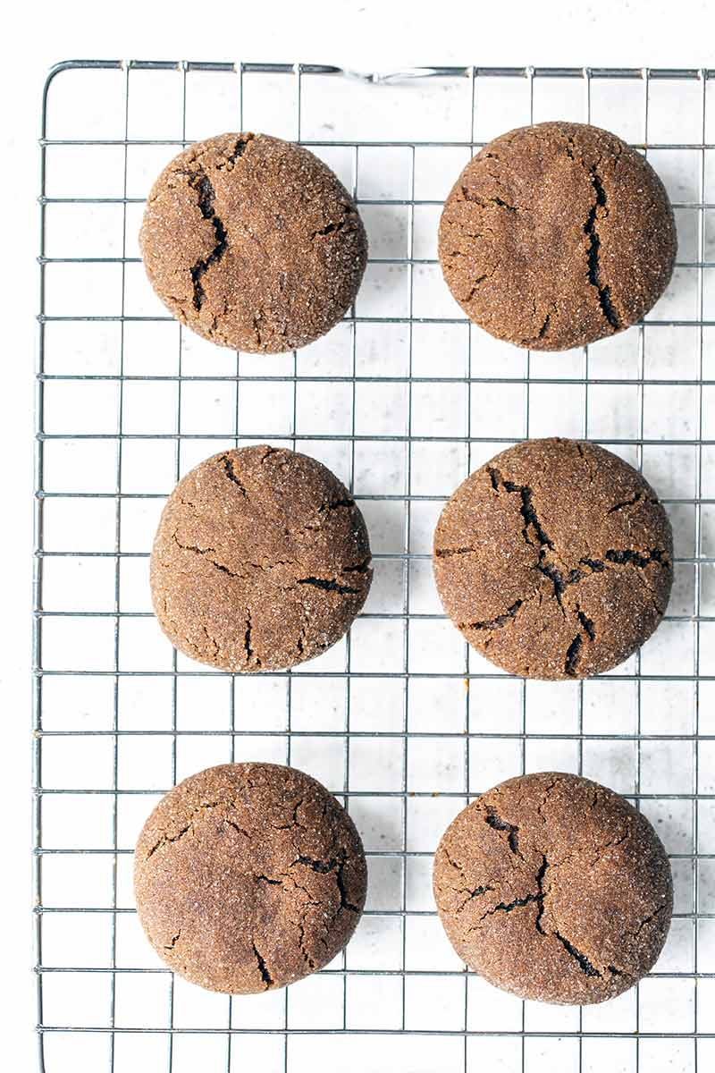 Soft and chewy molasses cookies on a cooling rack