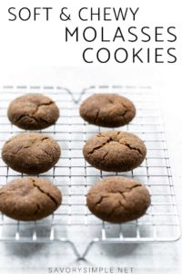 """Molasses cookies on a cooling rack with text overlay that says """"soft & chewy molasses cookies"""""""