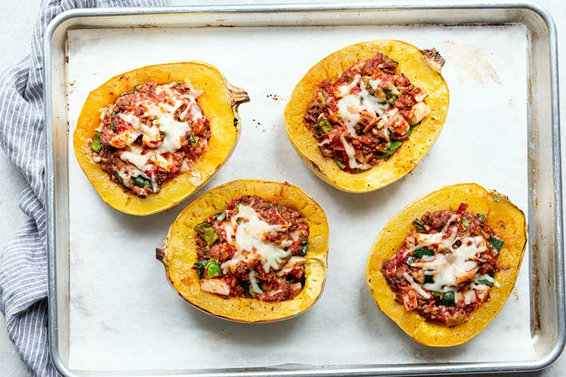 Italian sausage spaghetti squash boats just out of the oven, still on sheet pan