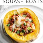 A Baked Spaghetti Squash Boat on a plate with a fork