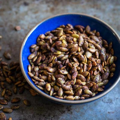 Sweet and Spicy Maple Roasted Pumpkin Seeds in a bowl