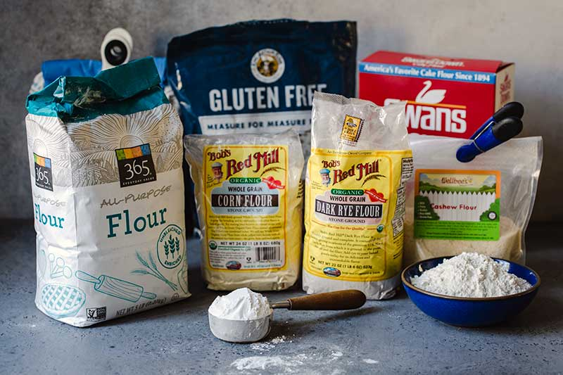 Different types of flours displayed in their bags