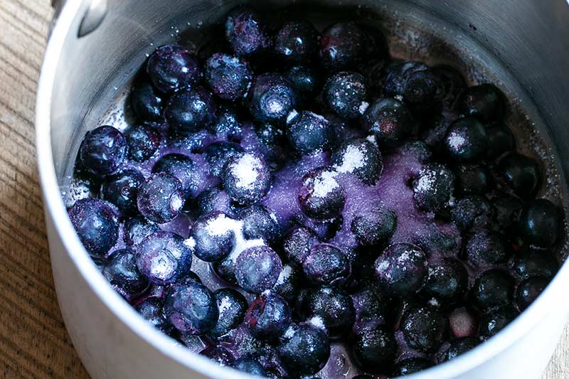 closeup of uncooked blueberry compote ingredients in saucepan