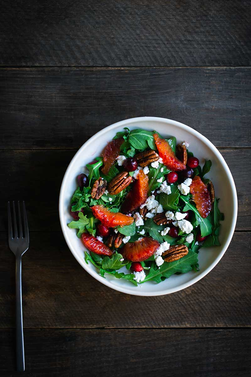 Cranberry pecan orange salad recipe in a salad bowl with a fork