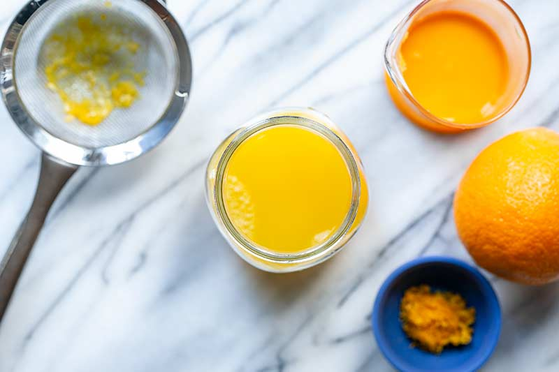 Orange juice pressed through a fine mesh strainer to remove pulp