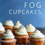 Six London fog cupcakes on a cooling rack, topped with lavender.