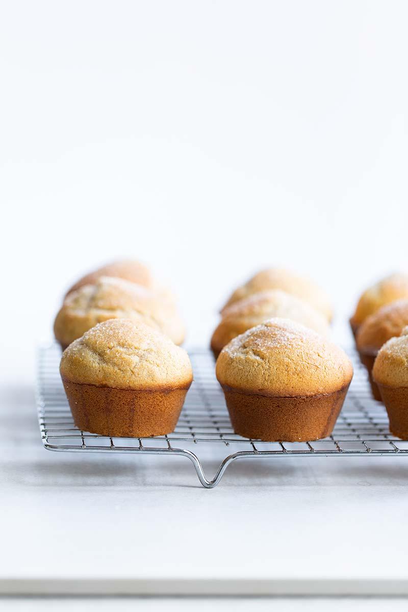 Cardamom cinnamon sugar muffins on a cooling rack