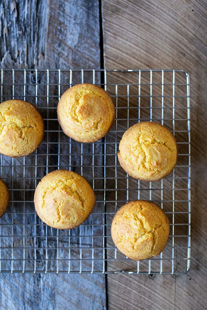Homemade corn muffin recipe on a cooling rack