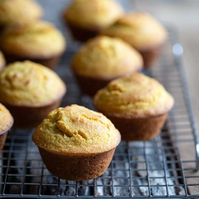 Homemade corn muffins on a cooling rack