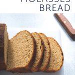Sliced oatmeal molasses bread on a cutting board