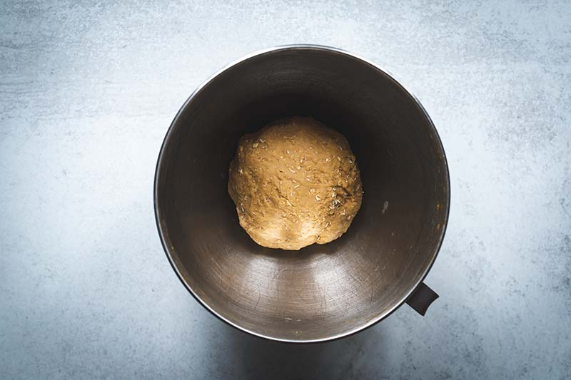 Bread dough in the bowl of a stand mixer