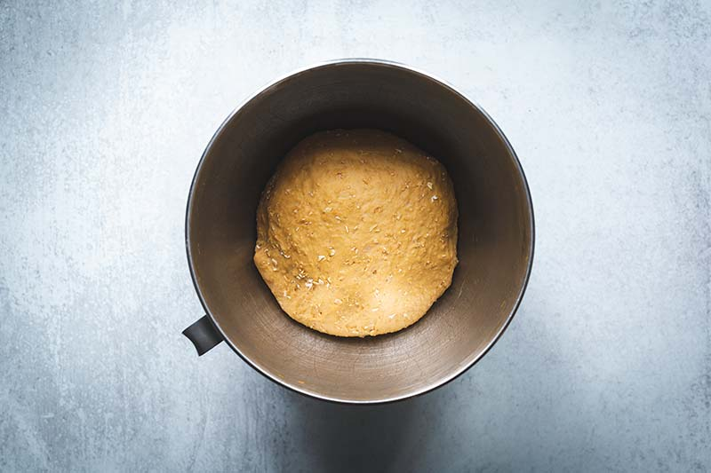 Bread dough in the bowl of a stand mixer after it has doubled in size