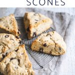 Chocolate chip scones on a round cooling rack and napkin