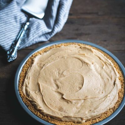 Peanut butter pie recipe next to a serving piece and napkin