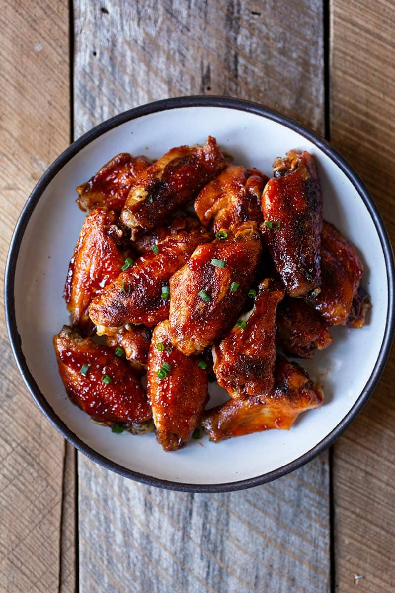 Gochujang wings in a bowl shot from overhead.