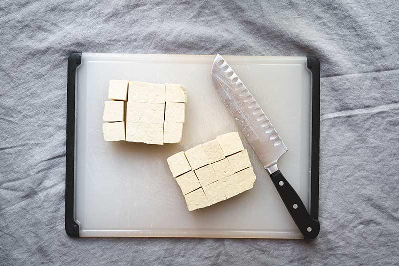 Sliced tofu on a cutting board