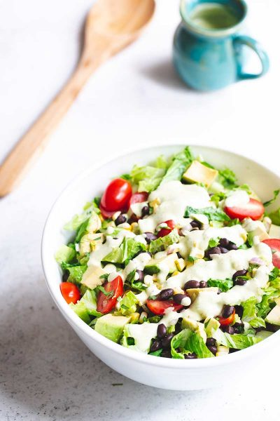 Mexican chopped salad topped with salad dressing