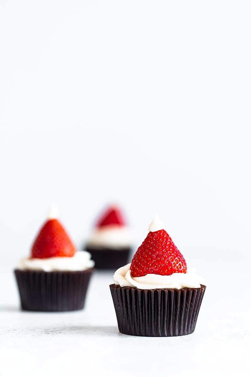 Santa Hat Cupcakes on a white backdrop