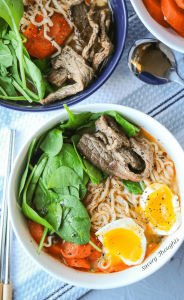 Spicy Beef Ramen Noodles . Easy beef soup recipe made with ramen noodles. Healthy and spicy. Soup made with eggs added and topped with spinach and carrots. Homemade, Authentic, and delicious. Easy and cheap to make. Best Spicy Ramen Noodle Soup. Full recipe at https://www.savorythoughts.com/spicy-beef-ramen-noodle-soup/
