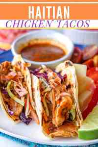 Insanely delicious Haitian Chicken Tacos that are loaded with juicy, slightly spicy tender chicken thigh strips, and topped with vibrant, refreshing pikliz as well as accompanied with marinated tomatoes. Perfect for Taco Tuesdays. Haitian Chicken | Mexican Meals | Chicken Tacos | Fusion Recipes | Savory Thoughts