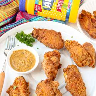 Party wings on marble plate with featuring Argo Corn Starch and Haitian Seasoning