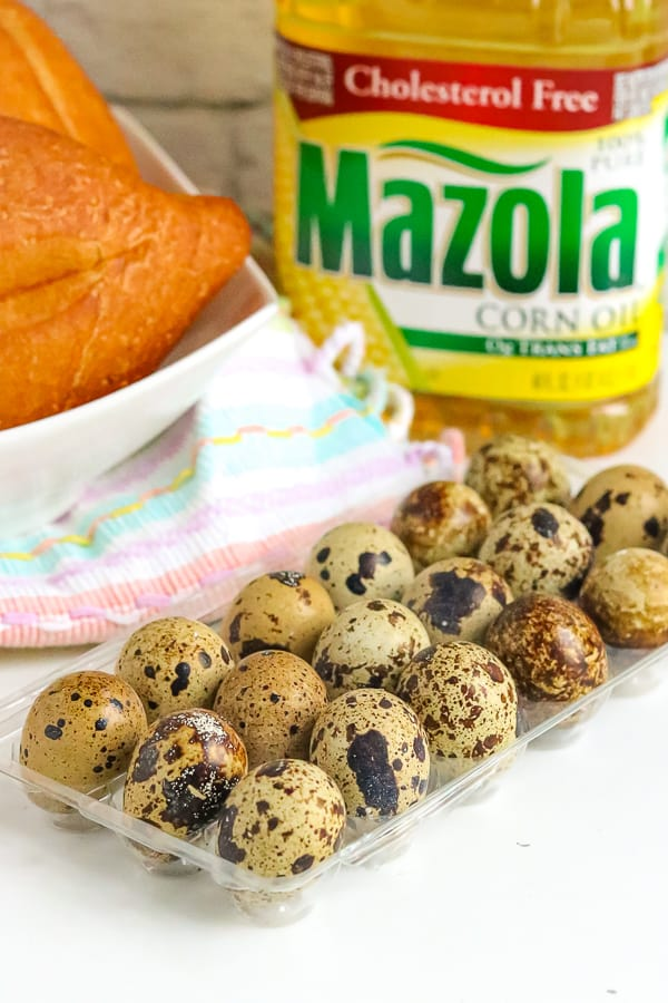 Quail Eggs in carton with Mazola oil