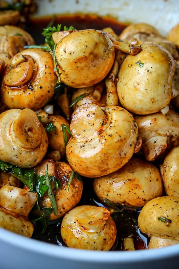 Raw garlic mushrooms tossed in seasoning
