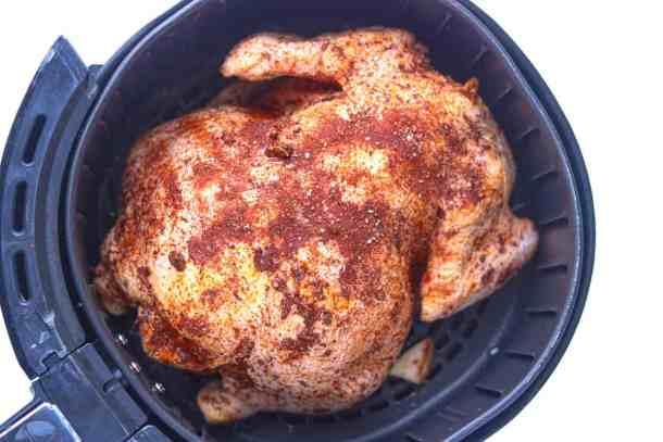 Seasoned chicken in air fryer basket