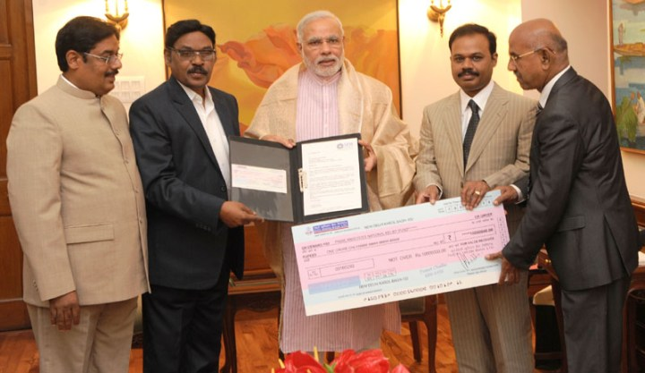 The Founder Chancellor, SRM University, Chennai, Dr. T.R. Pachamuthu calls on the Prime Minister, Shri Narendra Modi, and handed over a demand draft for Rs. 1 crore for the Prime Minister's National Relief Fund, in New Delhi on September 20, 2014.