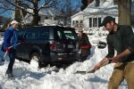 A man shoveling his neighbor's snow