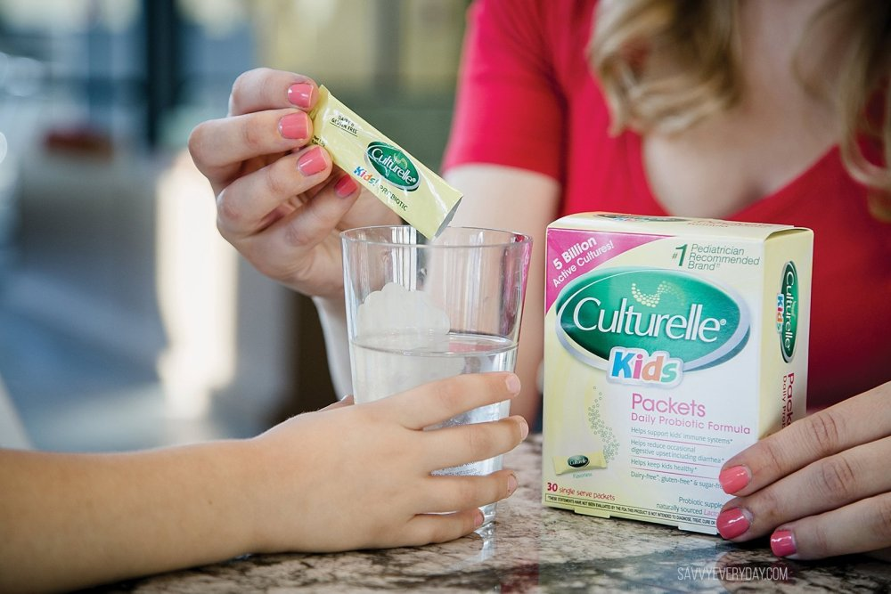 pouring Culturelle kids probiotic in a cup