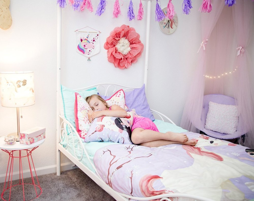 S sleeping in her unicorn room