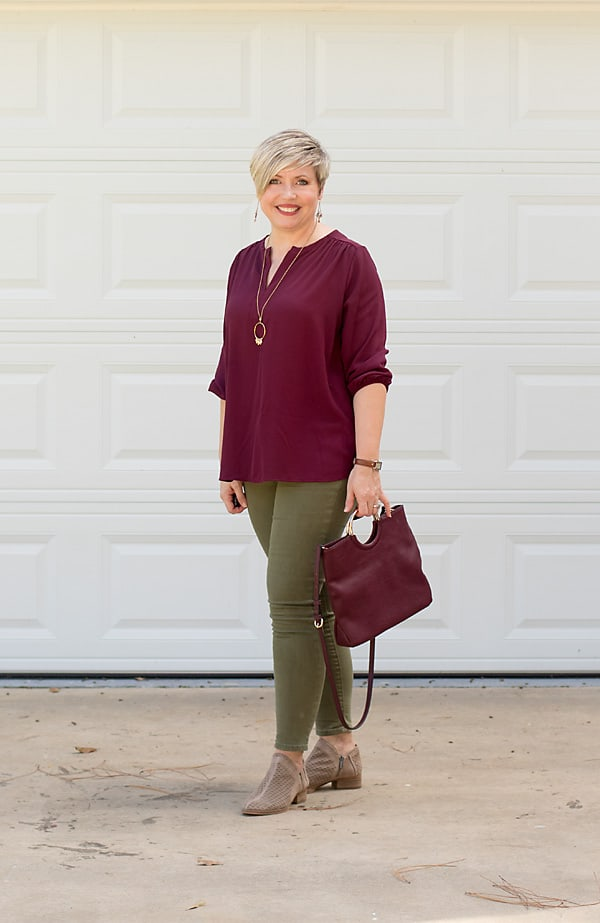olive jeans outfit with burgundy top