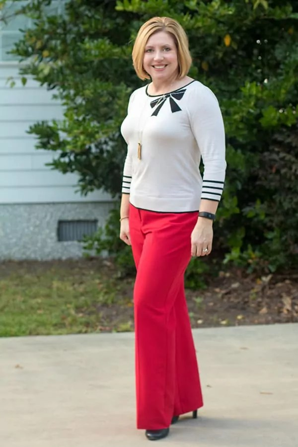 red pants and bow sweater top