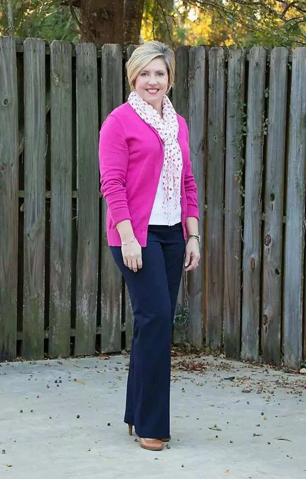 Hot pink cardigan and navy pants
