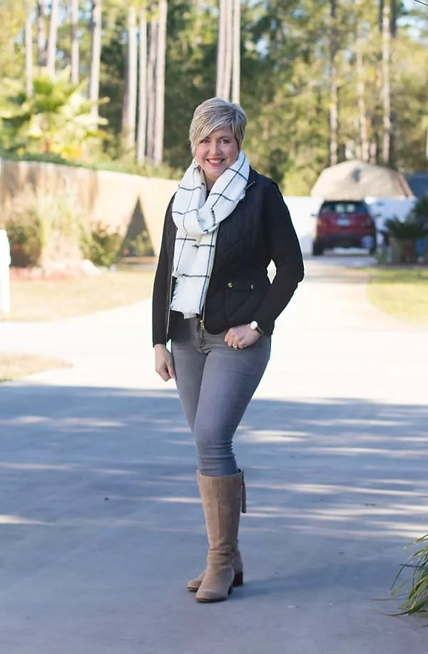 tall taupe boots with gray jeans and black sweater